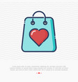 shopping bag with heart thin line icon vector image