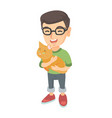 caucasian happy boy in glasses holding a cat vector image vector image