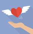 Hand with heart flying vector image vector image