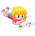 little girl lying and painting on a paper vector image vector image