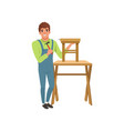 male professional carpenter building wooden chair vector image