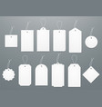 Blank white paper price tags or gift tags in