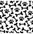 dog paw and bown seamless pattern vector image vector image