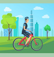 man in helmet rides bicycle through green park vector image vector image
