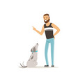 handsome man teaching his dog to sit bearded guy vector image vector image