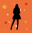 woman silhouette in leaves in the autumn vector image vector image