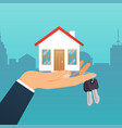 real estate agent holds key from home vector image vector image