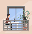 young man working with laptop on open balcony vector image