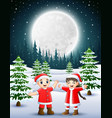 two kids wearing a red santa waving and laughing o vector image vector image