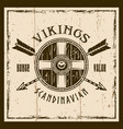 viking shield and crossed arrows emblem vector image
