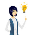 business woman pointing at business idea bulb vector image vector image