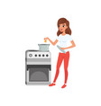 young woman cooking in the kitchen people vector image