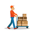 delivery man carrying boxes on a hand truck vector image vector image