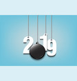 2019 new year and hockey puck hanging on strings vector image