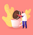 man dunking chocolate cookie with cream to cup vector image