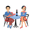 pair of young man and woman sitting at table
