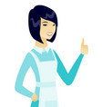young asian cleaner giving thumb up vector image vector image