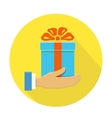 Isolated round flat icon Hand holding a blue gift vector image vector image