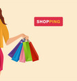 shopping hand holding shopping bags background vec vector image vector image