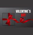 decorative black gift box with red bow isolated vector image