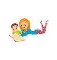 mother and son lying on the floor and reading a vector image vector image