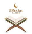 ramadan kareem text and open book koran vector image vector image
