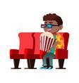 african boy wearing 3d glasses eating popcorn