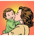 mother kissing baby vector image vector image
