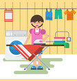 woman in laundry is washing and ironing vector image