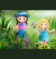happy little girls picking a flowers in the garden vector image