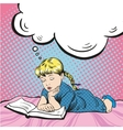 Little girl reading book on a bed vector image