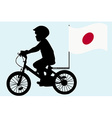 A kid rides a bicycle with Japan flag vector image vector image