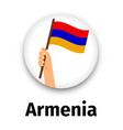 armenia flag in hand round icon vector image vector image