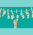 wet dollar bills hanging on rope vector image vector image