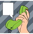 Hand holding a phone pop art vector image