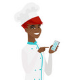 young african-american chef holding mobile phone vector image vector image