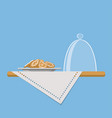 plate with cookies on shelf with linen napkin vector image