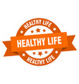 healthy life ribbon healthy life round orange vector image vector image
