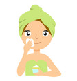 beautiful young woman applying facial mask spa vector image
