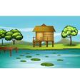 A hut at the riverbank vector image vector image