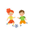 flat boy girl character playing football vector image