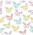 Seamless pattern with colorful bunnies vector image