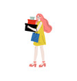 young beautiful woman carrying boxes and shopping vector image vector image