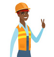 young african builder showing victory gesture vector image vector image