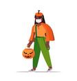 girl in mask wearing pumpkin costume halloween vector image
