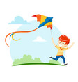 boy runs and launches a kite into sky vector image vector image