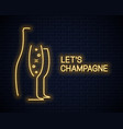 Champagne bottle neon banner and champagne glass