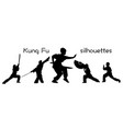 silhouettes of children showing kung fu vector image