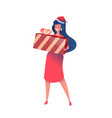 woman in dress santa hat with present box vector image vector image