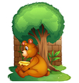 A bear sitting under a big tree vector image vector image